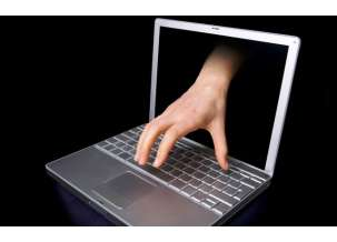 a-hacker-concept-image-of-a-hand-coming-through-the-computer-computer-virus